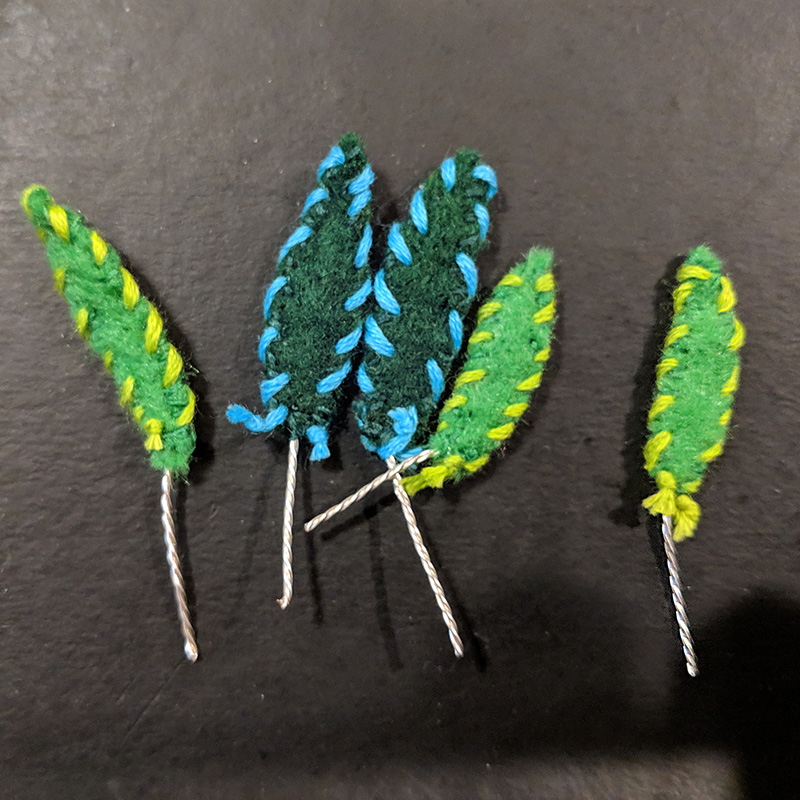 Leaves of the potted plant necklace made from felt and embroidery