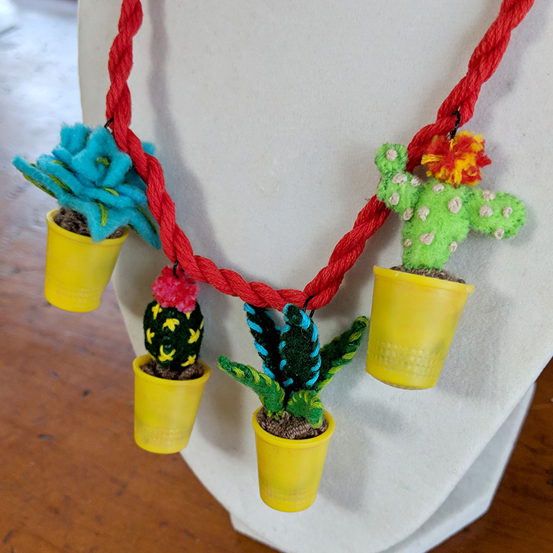 A close-up of the final potted plants necklace.