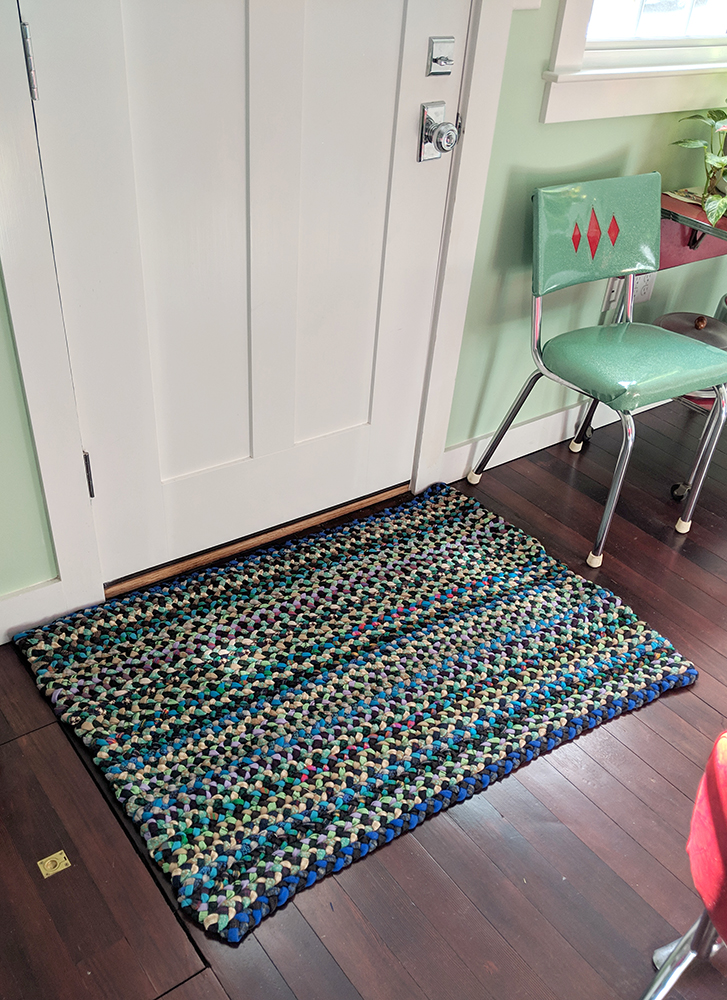 The final rug in front of the door