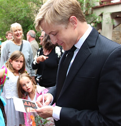 Signing autographs for children after the Family Matinee of The Barber of Seville at Central City Opera.