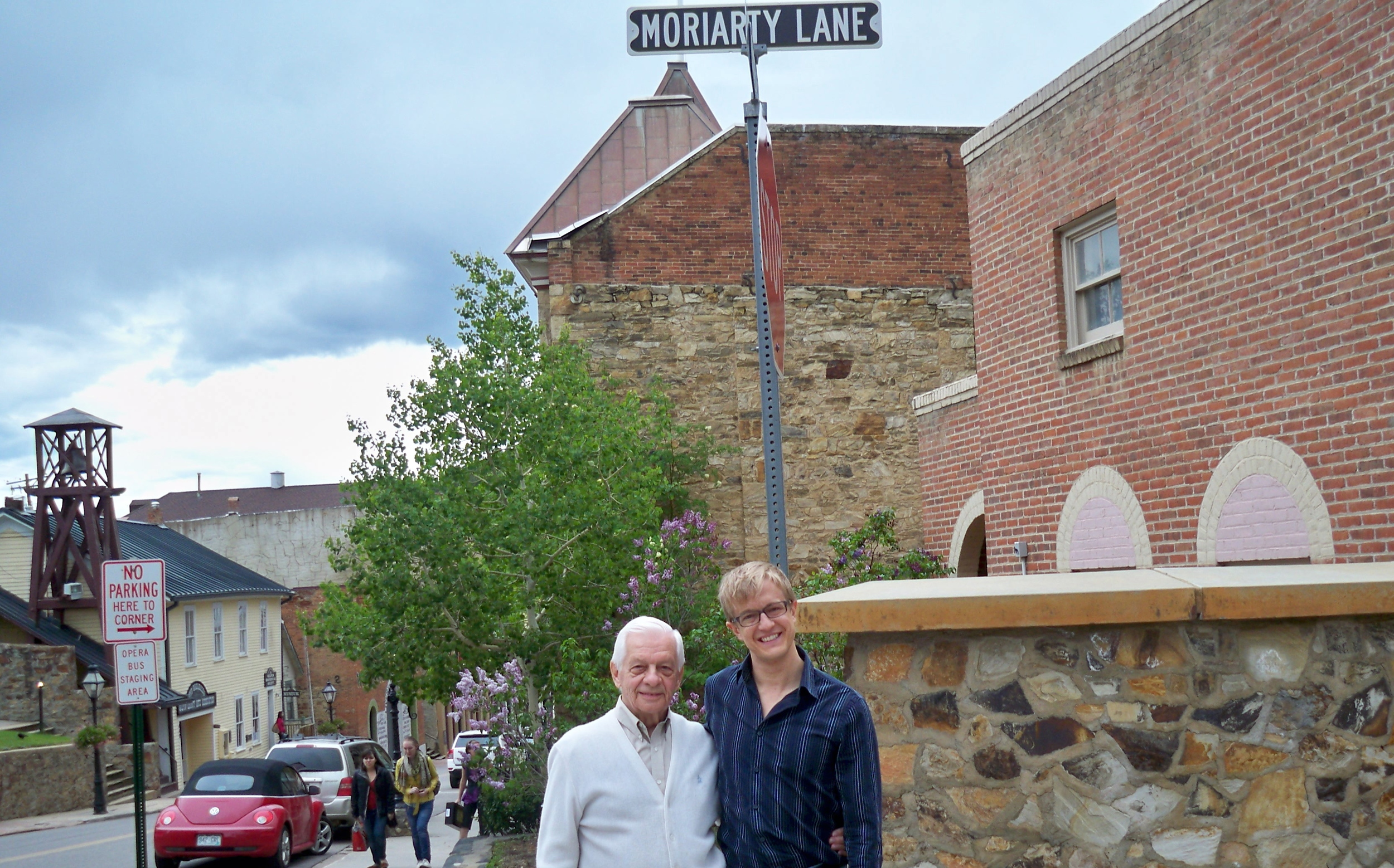 """With conductor, pianist, author, linguist extraordinaire and fellow Francophile John Moriarty, Artistic Director Emeritus of Central City Opera, on his eponymous """"Moriarty Lane"""" in Central City, Colorado."""