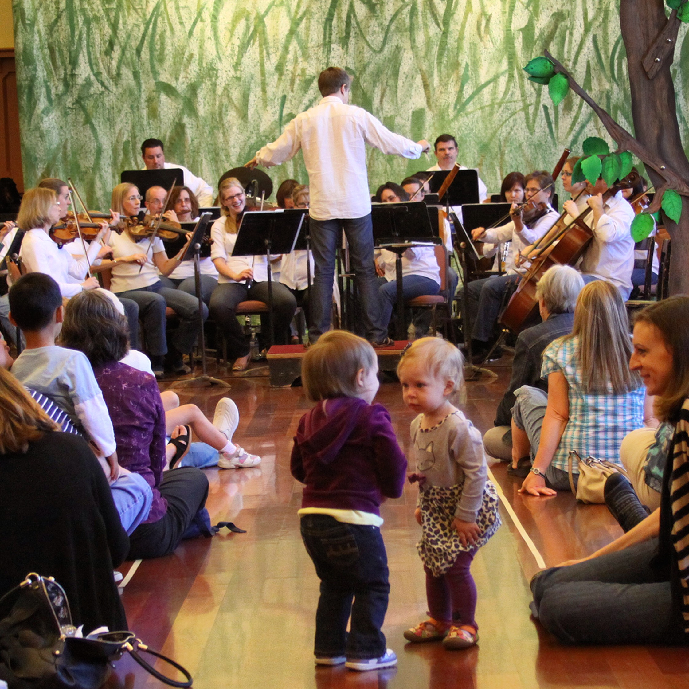 One of my favorite pictures. I'm conducting while children literally dance in the aisles hearing an orchestra for the first time.