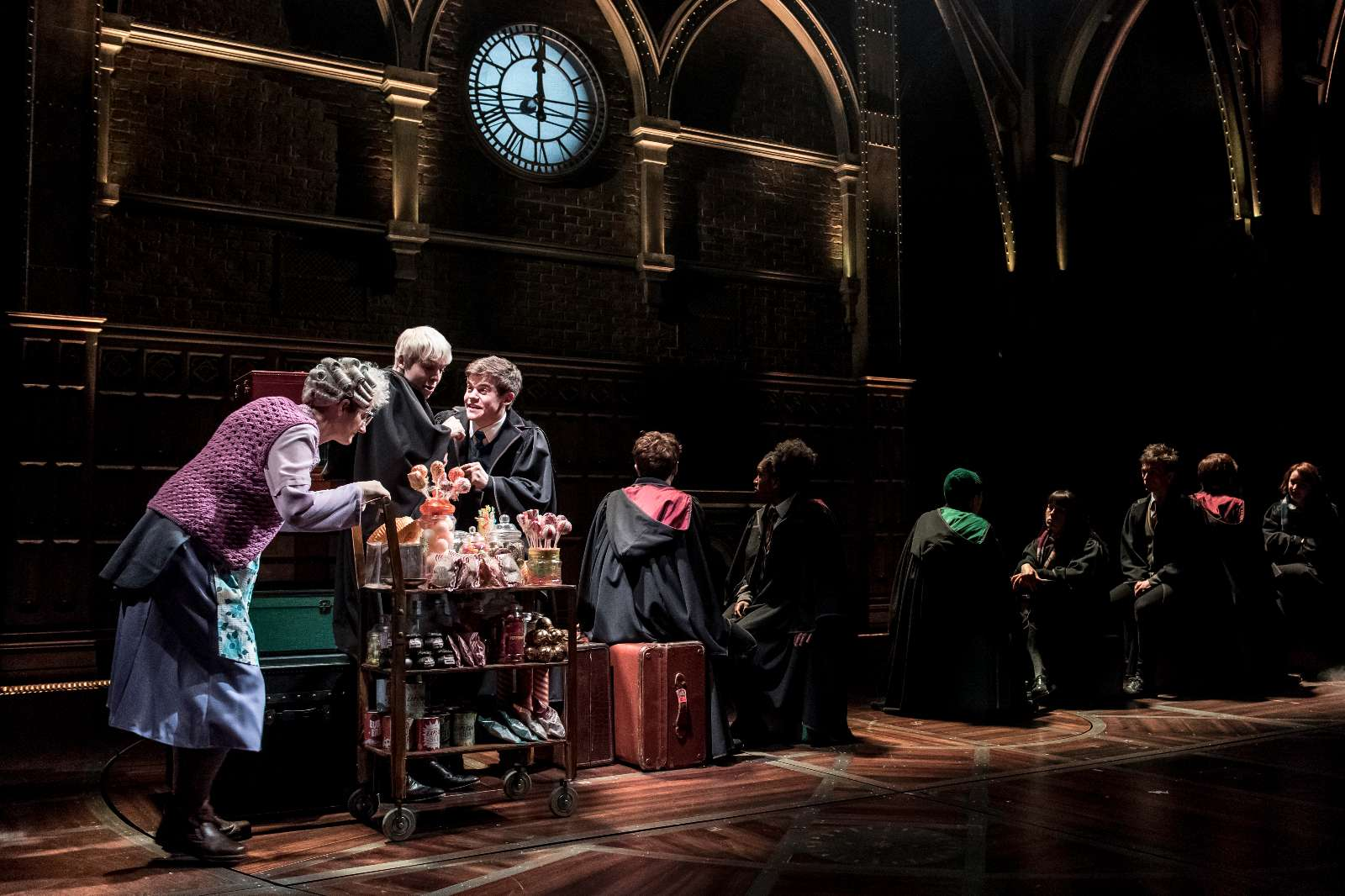 L-R Sandy McDade (Trolley Witch), Anthony Boyle (Scorpius Malfoy), Sam Clemmett (Albus Potter) and the cast of Harry Potter and the Cursed Child; Photo by Manuel Harlan - http://www.harrypottertheplay.com/
