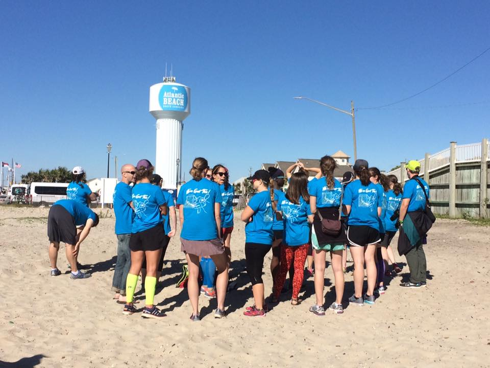 Waiting at the finish line for our final two runners to join us. Photo credit:  Barney Caton