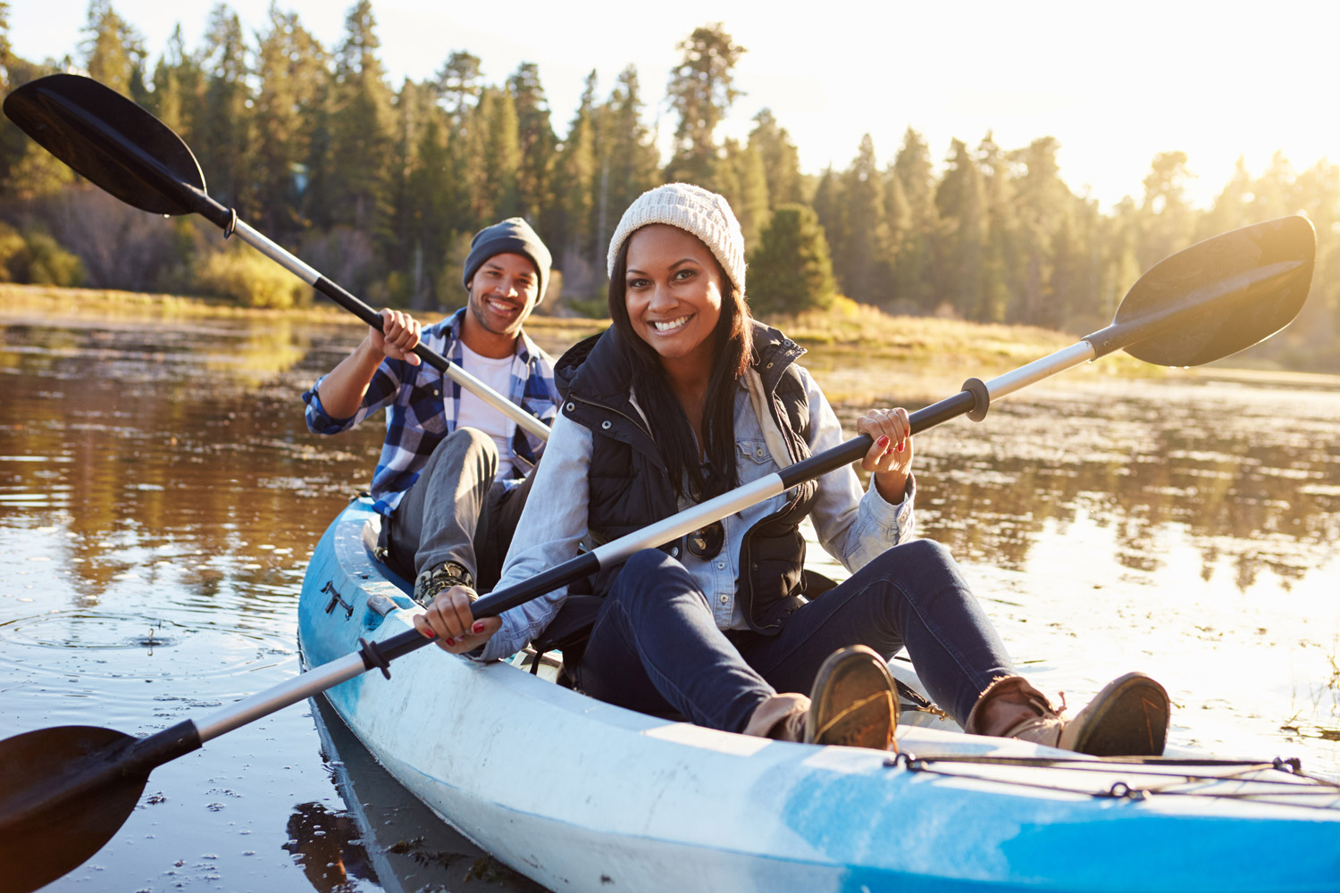 Isn't this the cutest kayaking photo?! Except maybe wear some life vests as needed. (Licensed Adobe stock image)
