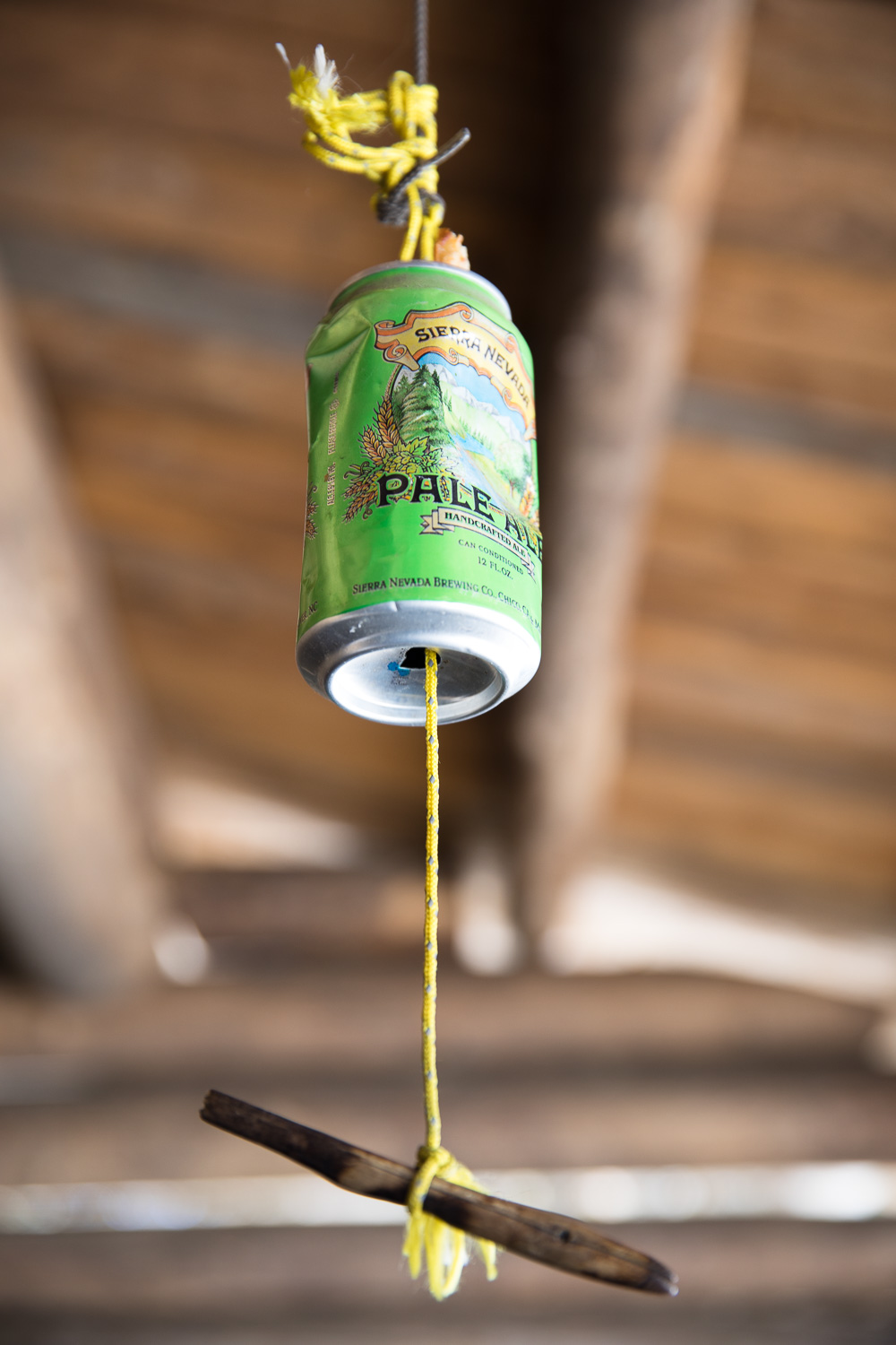 A place to hang your pack. The beer can prevents mice from getting to your pack.