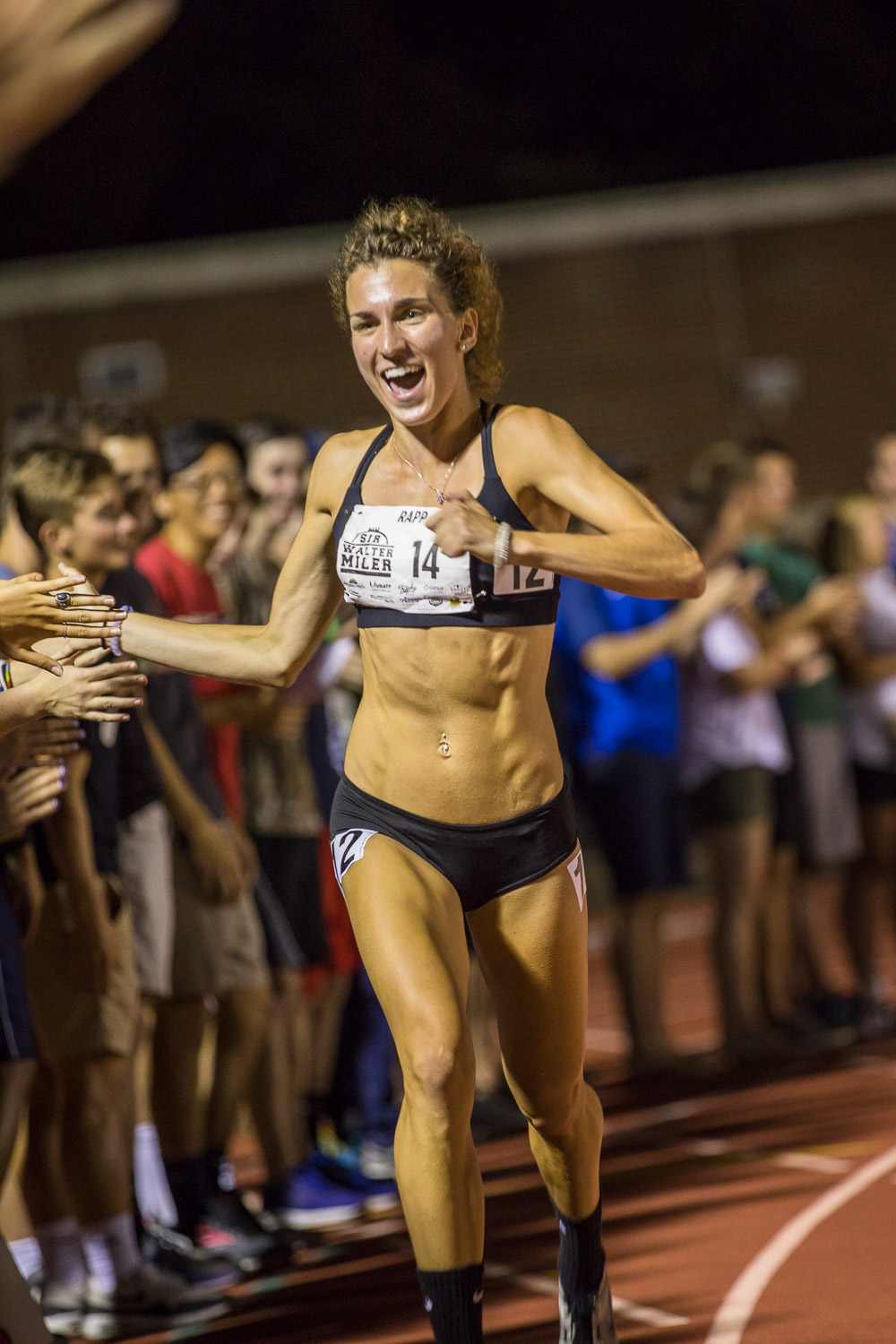 Sarah Rapp gives high fives before the start of the women's elites race