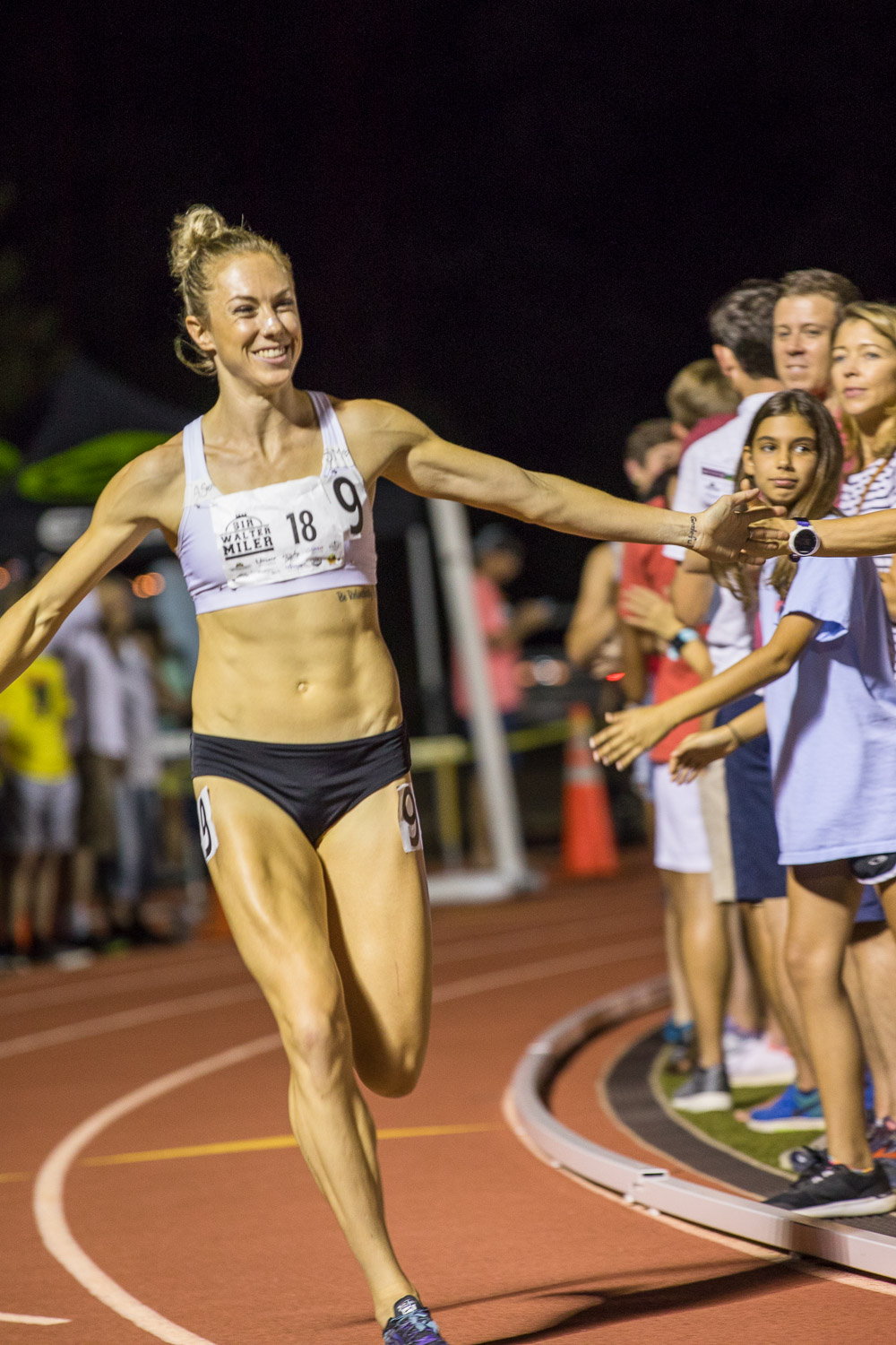 Kate Van Buskirk gives high fives before the start of the women's elites race