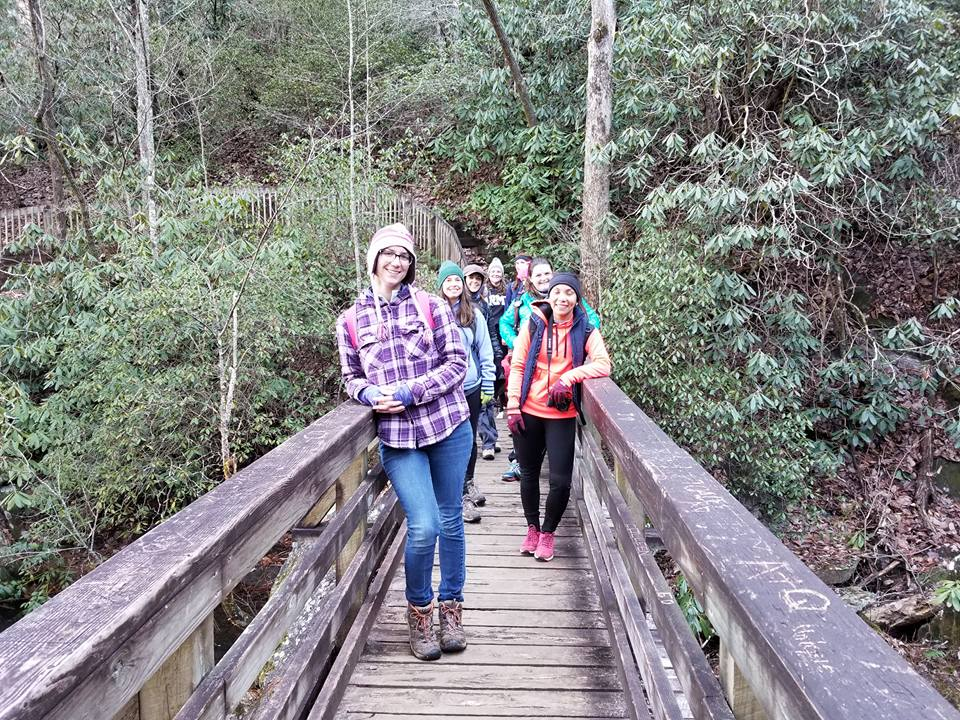 Girls Who Hike NC meet-up at the bridge crossing at the top of the falls. Photo credit: Rachel Shannon