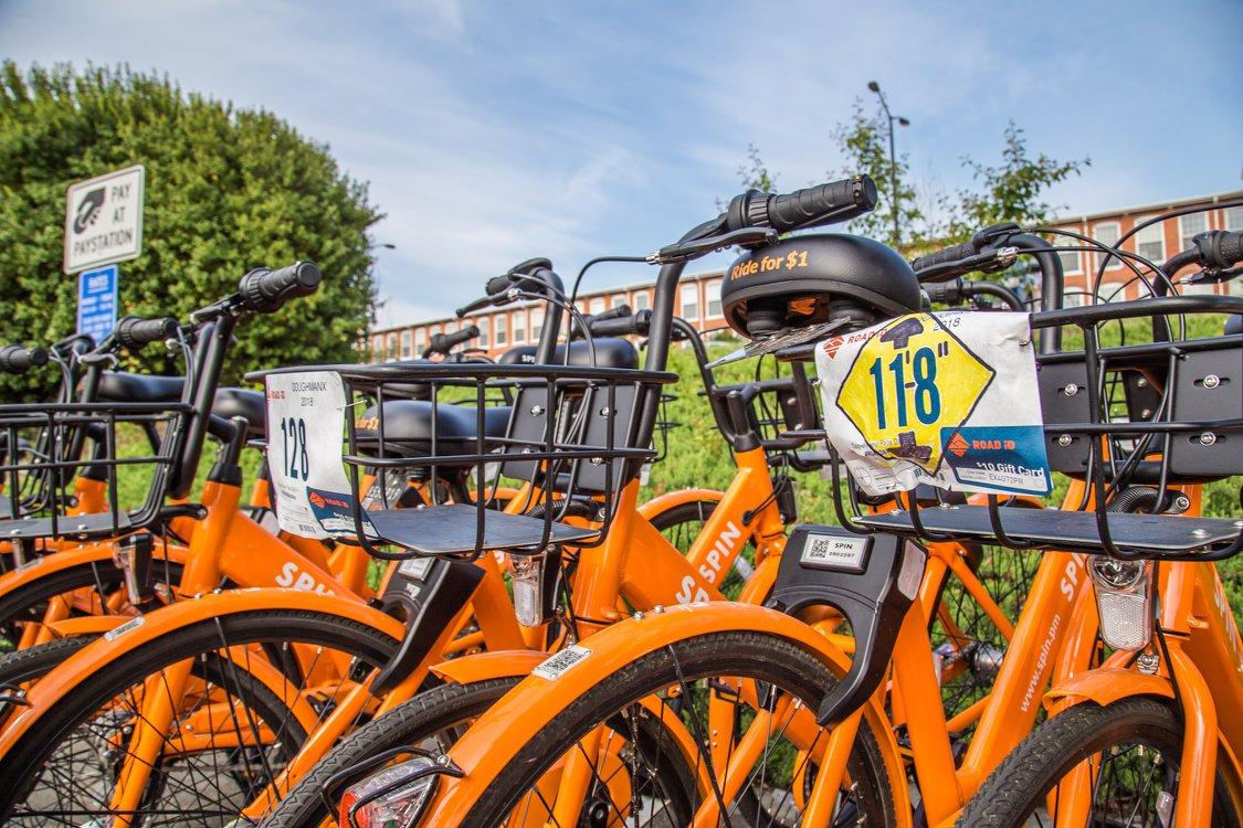 "Orange rental bikes from ride-share ""Spin"" at Doughman X. Photo courtesy of  Doughman"
