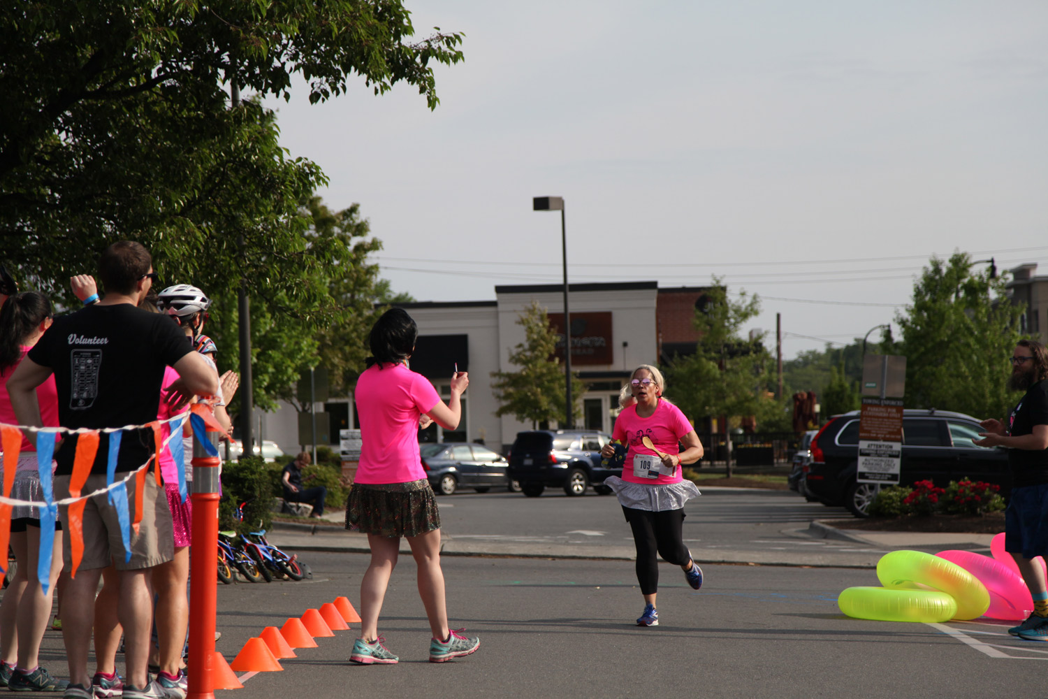 Jill finishing up her running leg and handing off the baton to Lauren. Photo courtesy of Michael Peace.