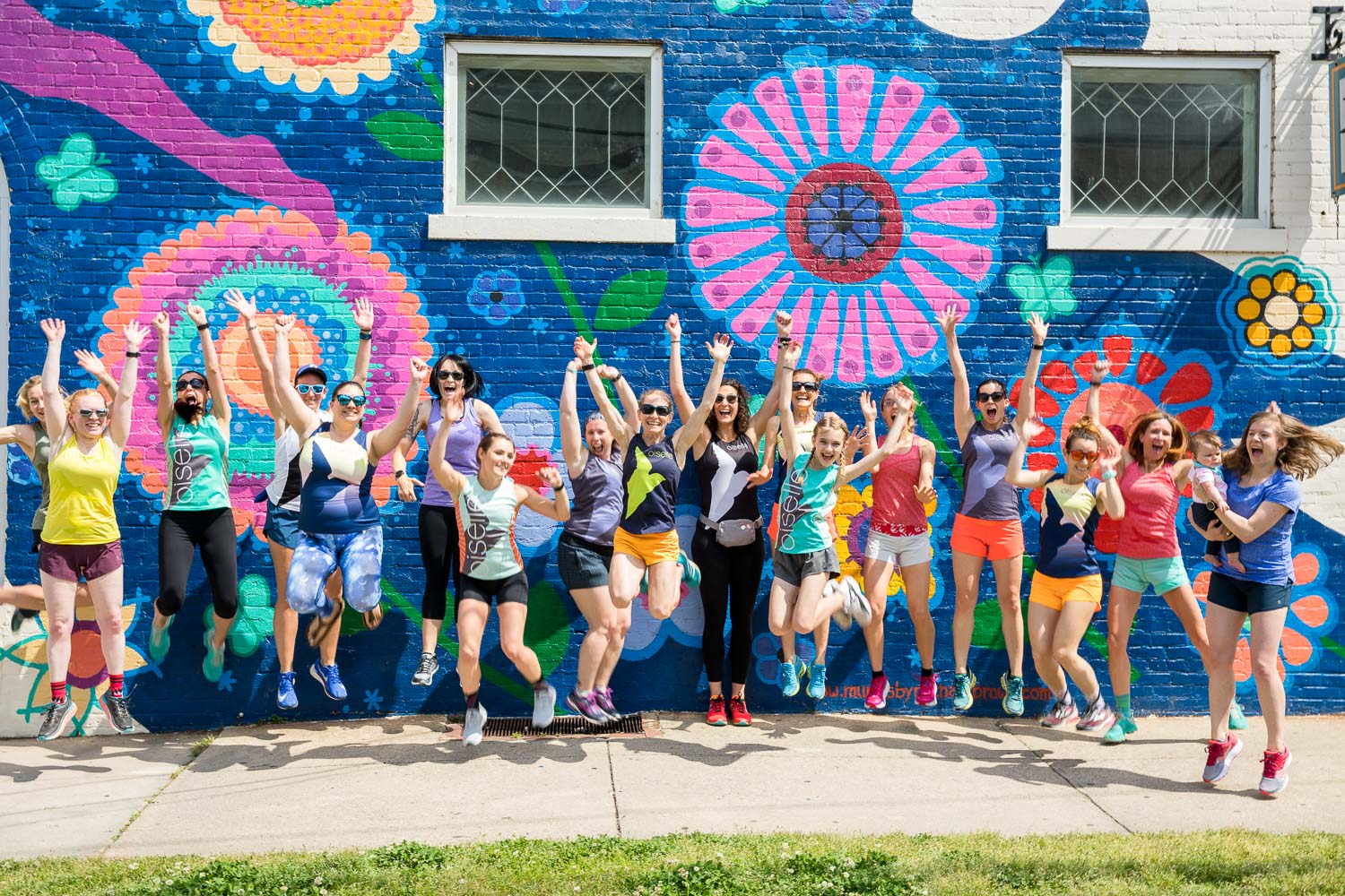 Some local members of Oiselle NC Volee team jump for joy!