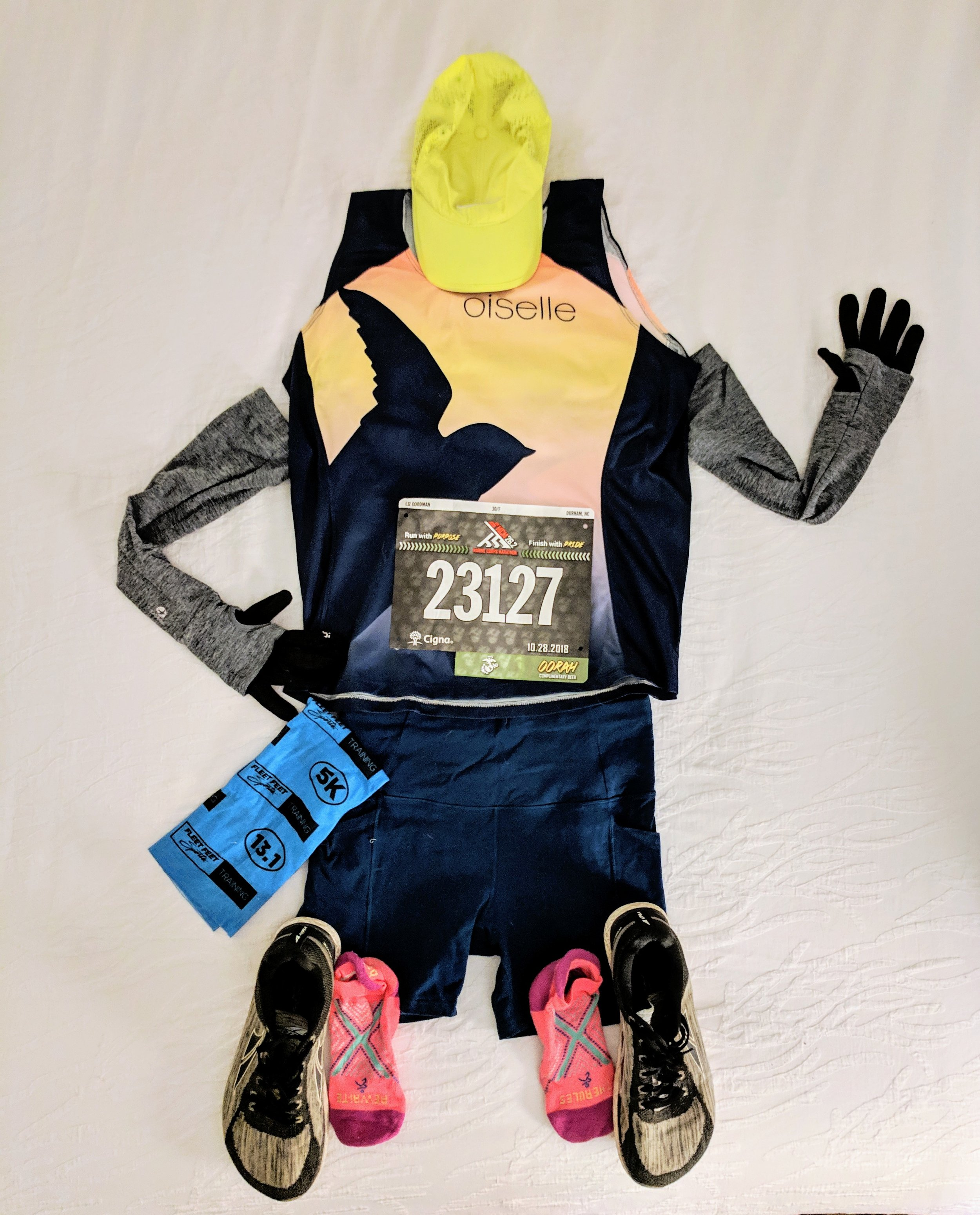 Flat Liz Version 1. Apparently it's a thing to take a photo of your race outfit the night before your marathon as you lay out everything in preparation. Except…well…you know me. I have to ruin everything. See Version 2…