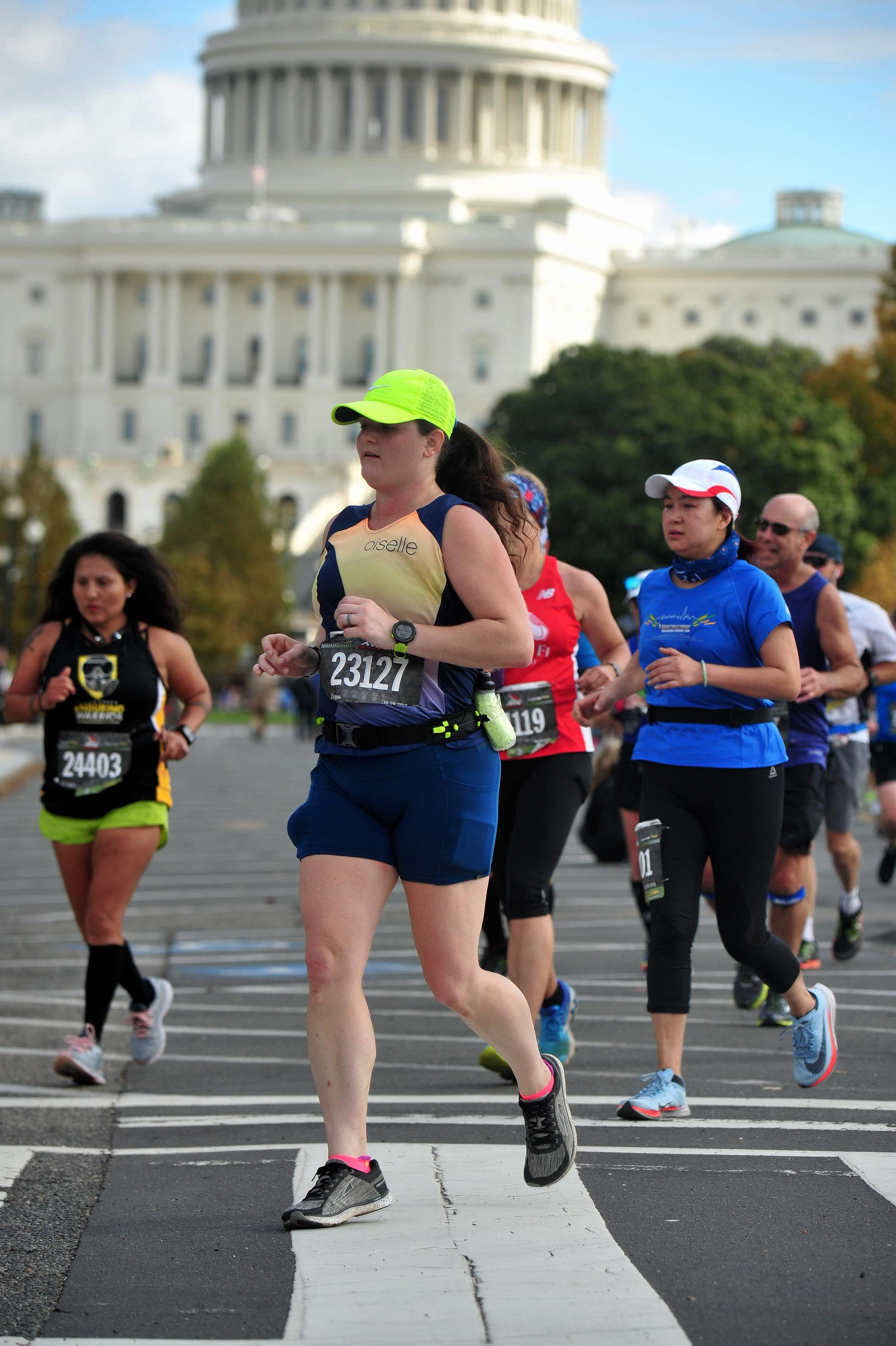 MCM photo outside the Capitol. I really regret putting my buff in my shorts pocket right about now. (photo purchased for use from Marathon Foto).