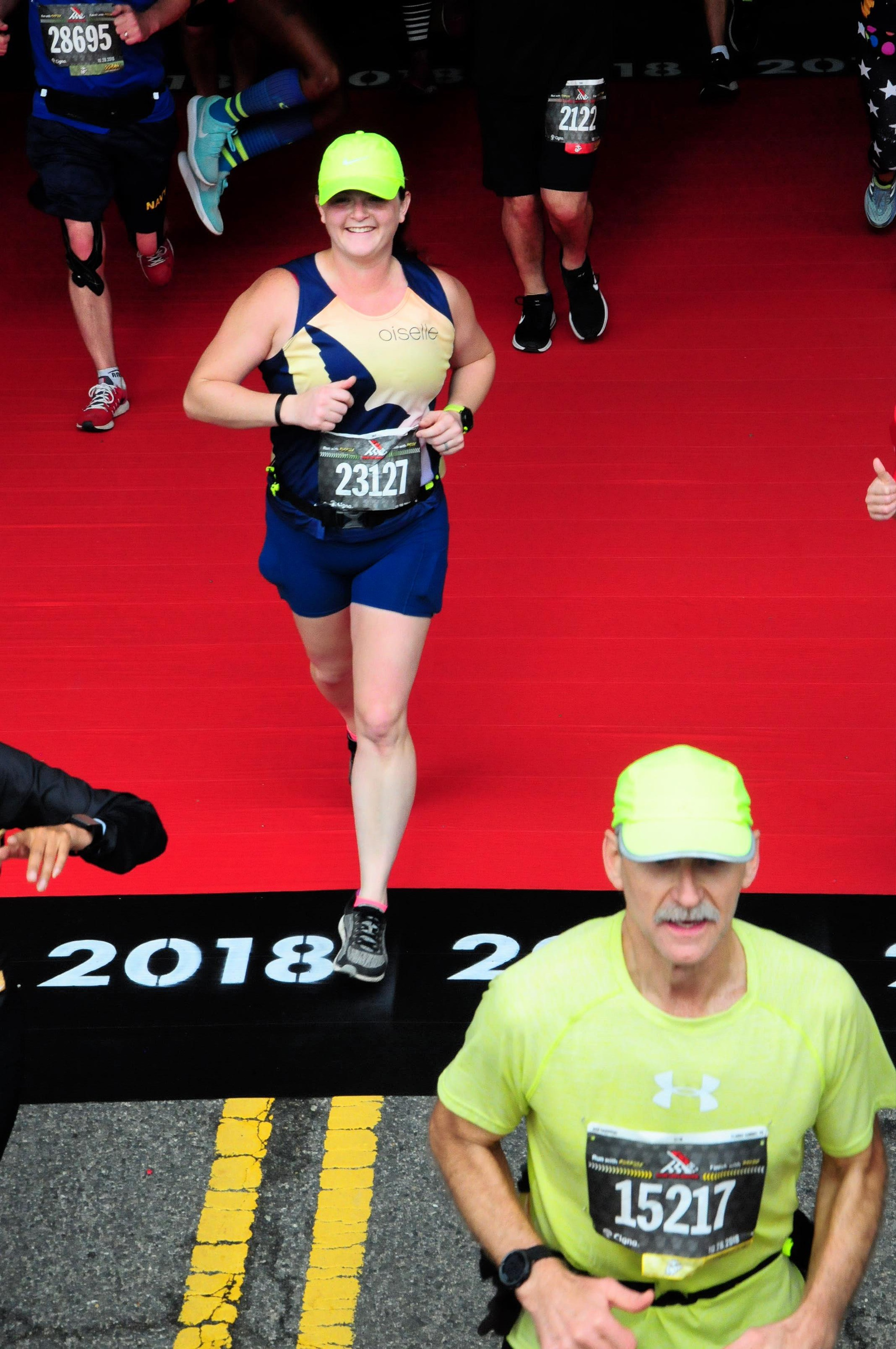 """I LOVE RUNNING!""… ""And I know for a fact there are a ton of photographers camped out here right now. SMILING!!"" (photo purchased for use from Marathon Foto). (Not the finish line photo, but I liked this photo the best from the photo package)"