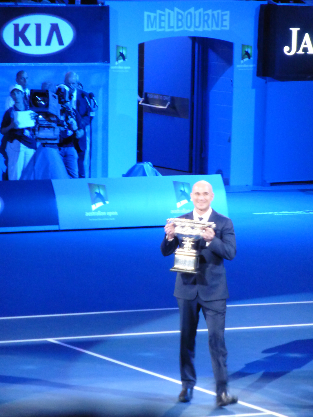 Andre Agassi brought out the trophy for display
