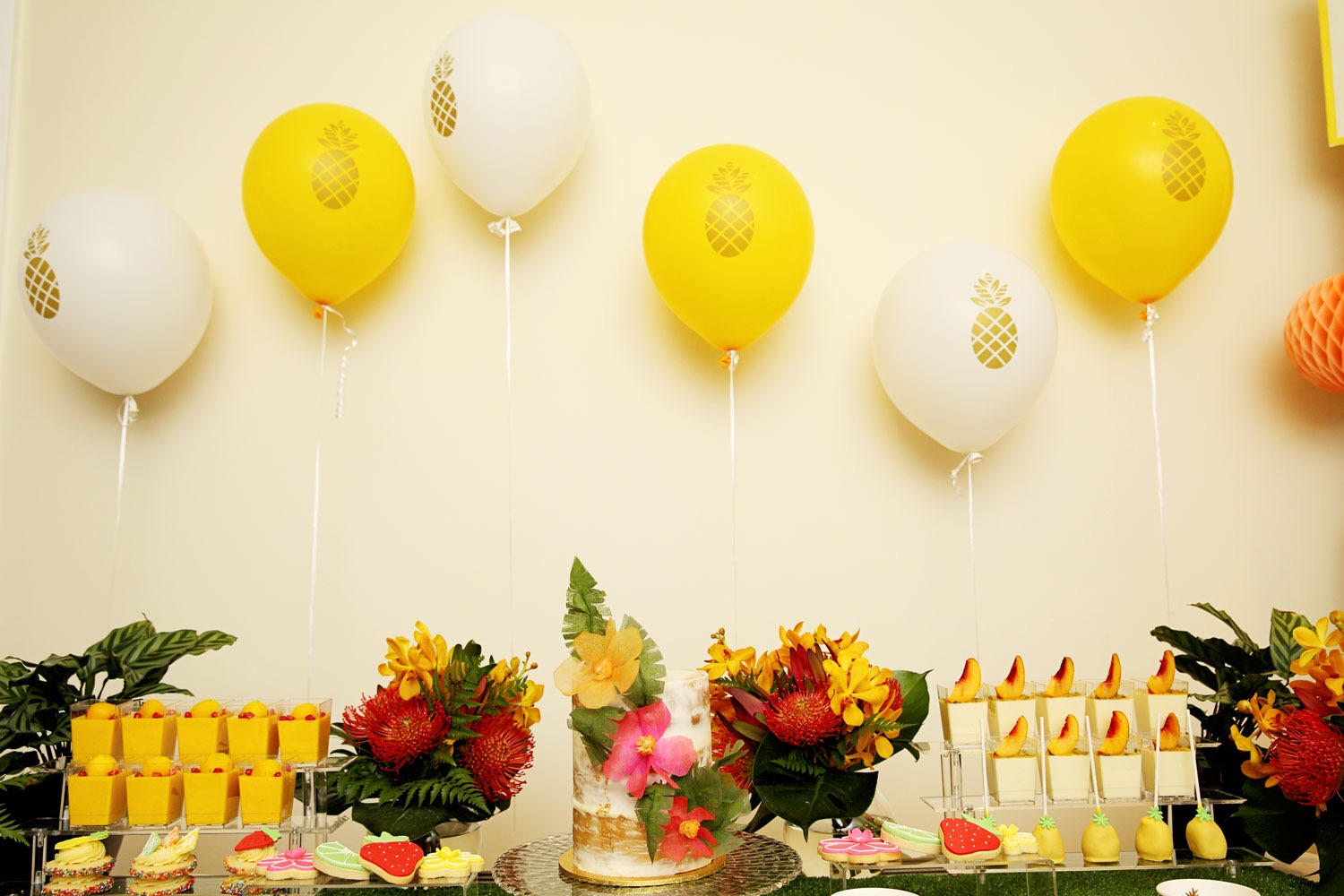 These gold foil stamped balloons from Love the Occasion provide a simple backdrop for the wall - perfect for situations where you can't attach decorations directly to the wall.