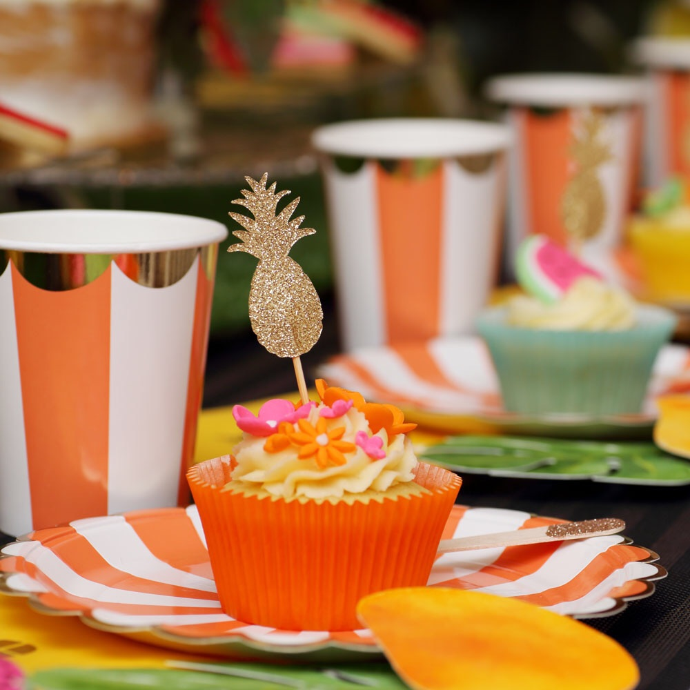 These colourful plates and cups by Meri Meri were supplied by Love the Occasion as were the glittery pineapple cake toppers. Cupcakes by One Sweet Chick.