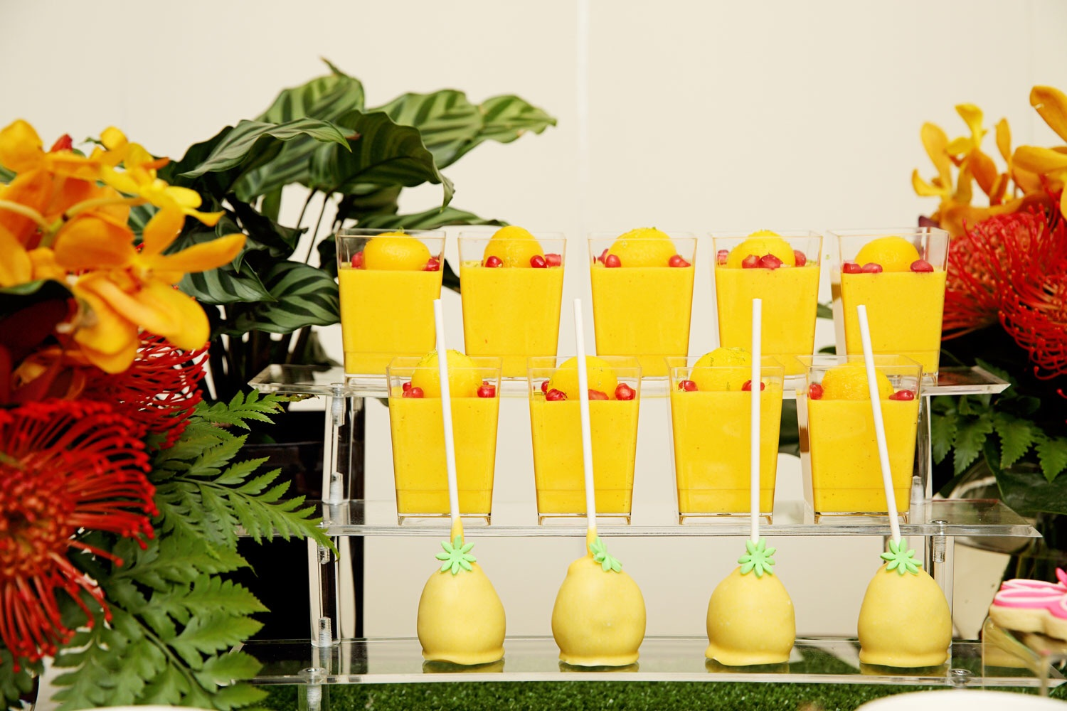 These mango mousses are topped with fresh mango and pomegranates and a grate of lime zest and are made by the talented Lopa from The Pumpkin Carriage. The pineapple cake pops are by One Sweet Chick