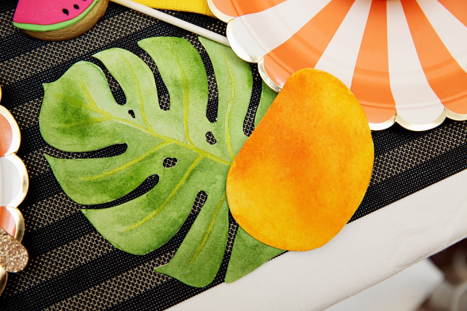 I created the monstera leaves and mangoes specifically for this party. Each one is hand-painted with watercolours and hand cut and make a colourful addition to the table setting.