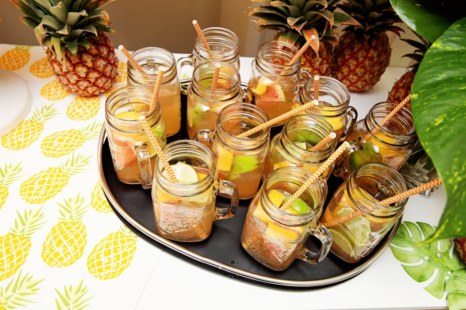 Pink lemonade with grapefruit and lime wedges