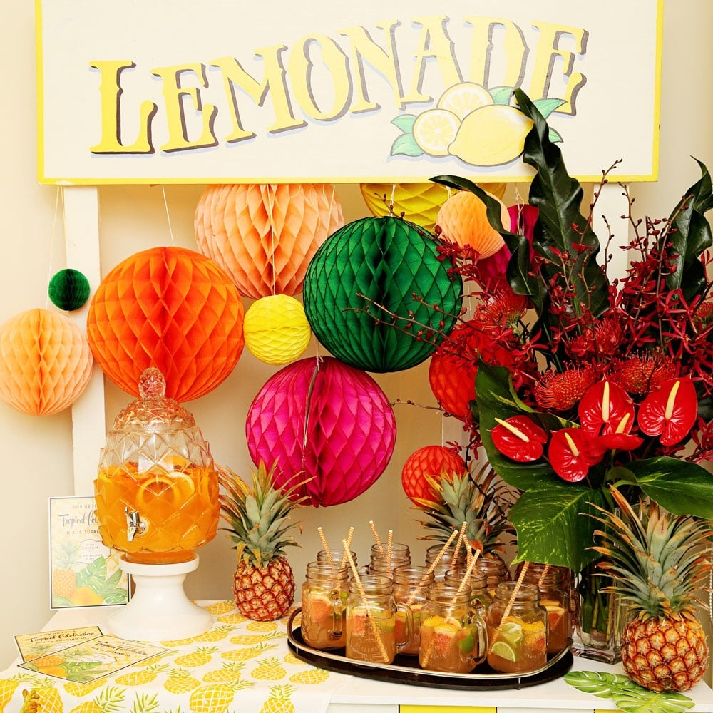 Honeycomb balls from Love the Occasion. The magnificent flower arrangement is by Fiddlesticks Floral Designs.