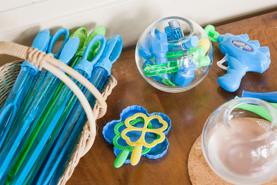 A selection of bubble wands and jars filled with bubble liquid set out for people to help themselves to create bubbles.