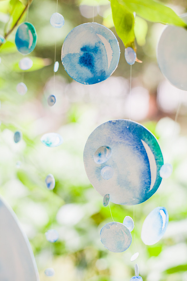 Each watercolour bubble was individually hand-painted on both sides and strung on fishing wire so that they could spin delicately through the air.