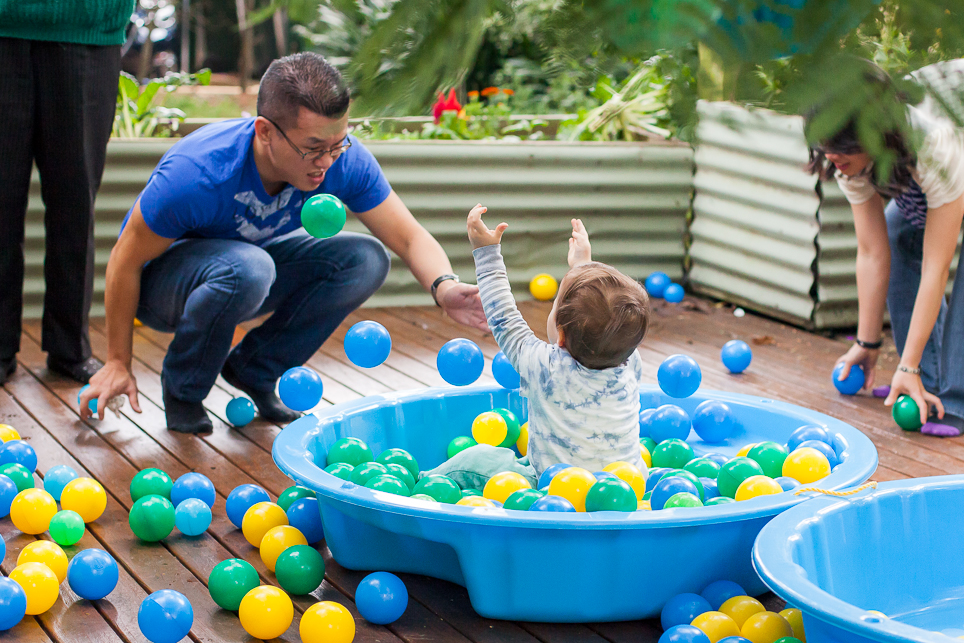 A classic clamshell ball pit was set up on the deck and filled with ball pit balls in blue, green and yellow to keep the look fresh and light.
