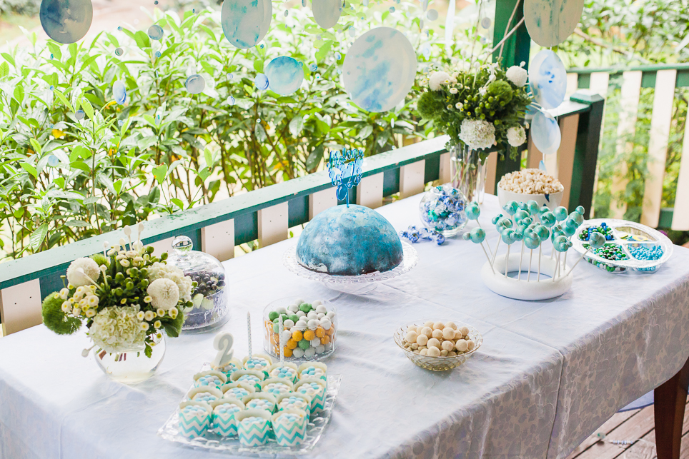 The dessert table setup with bubble inspired sweet treats.