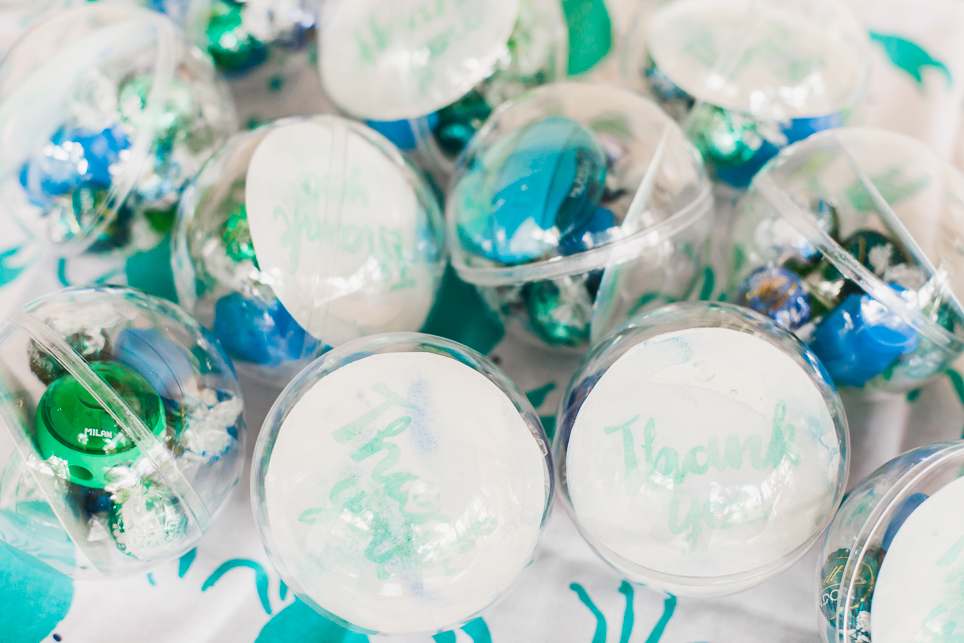 Perspex sphere favour boxes were filled with bubble inspired chocolates and gifts.