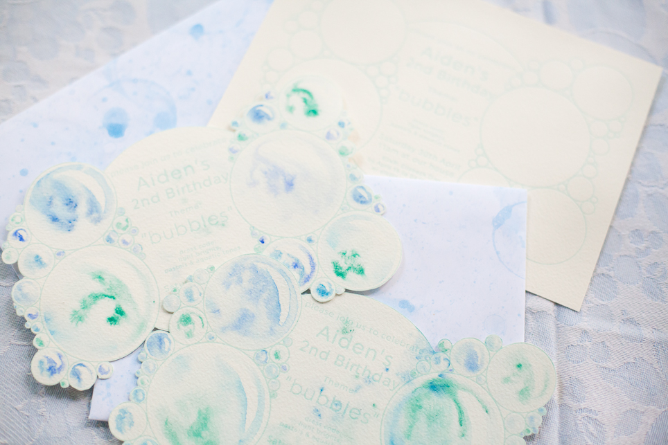 The invitations were letter-pressed before the bubbles were individually hand-painted with watercolours and die cut. Matching soap bubble paint envelopes completed the look.