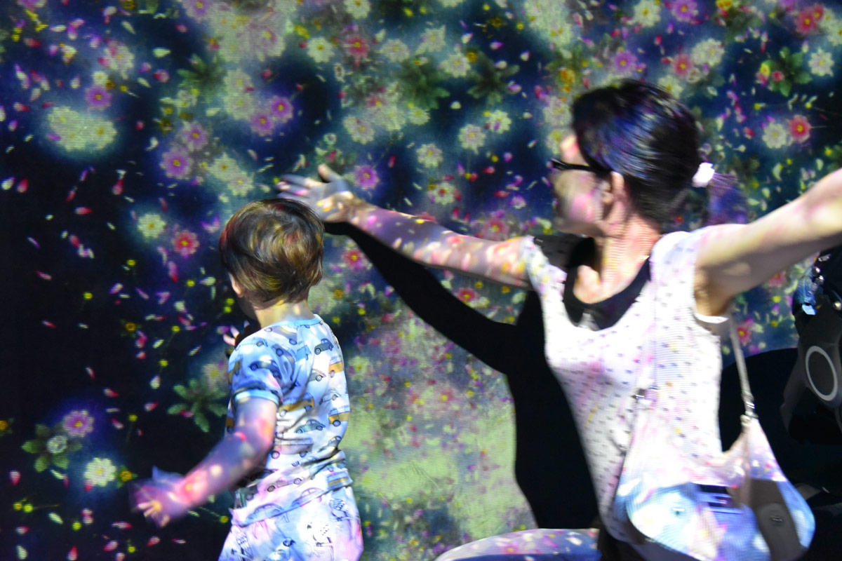 Exploring the floral projections at the Future Land exhibition. Aiden was fascinated by the colours sticking to his skin.