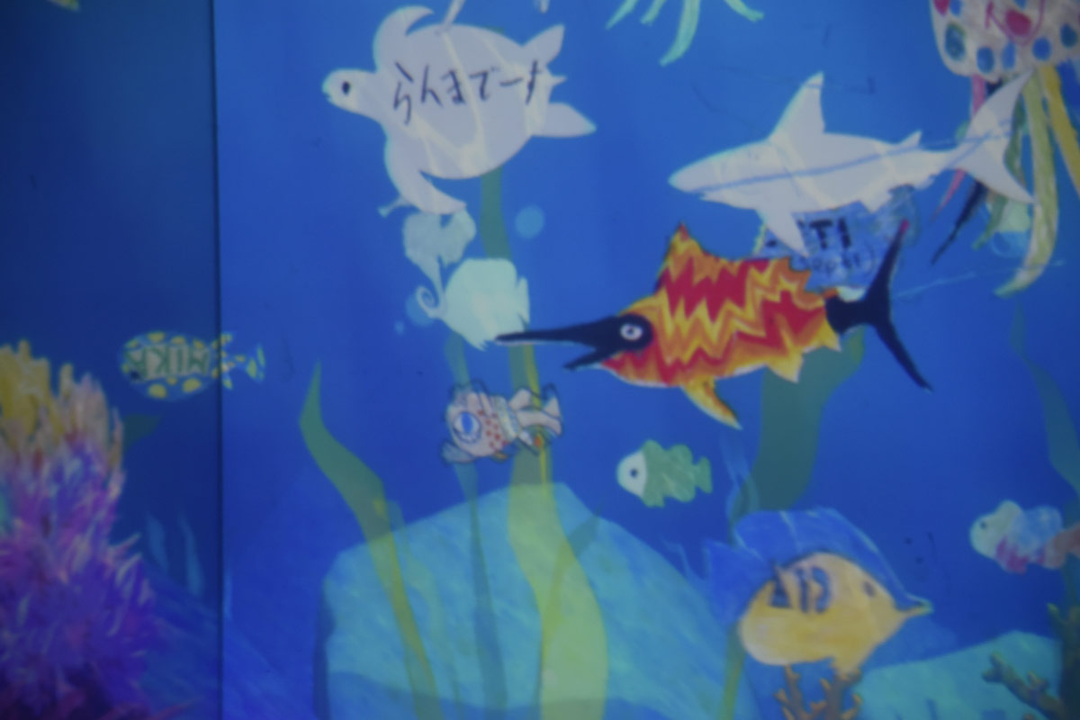 The animals then come to life swimming on the art gallery walls. Here Aiden's shark swims just above my colourful geometric swordfish.