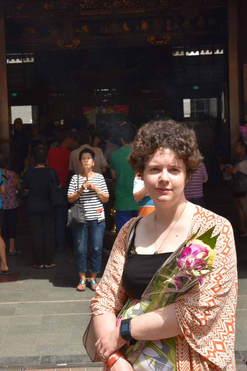 We bought fresh flowers and incense to leave as offerings.