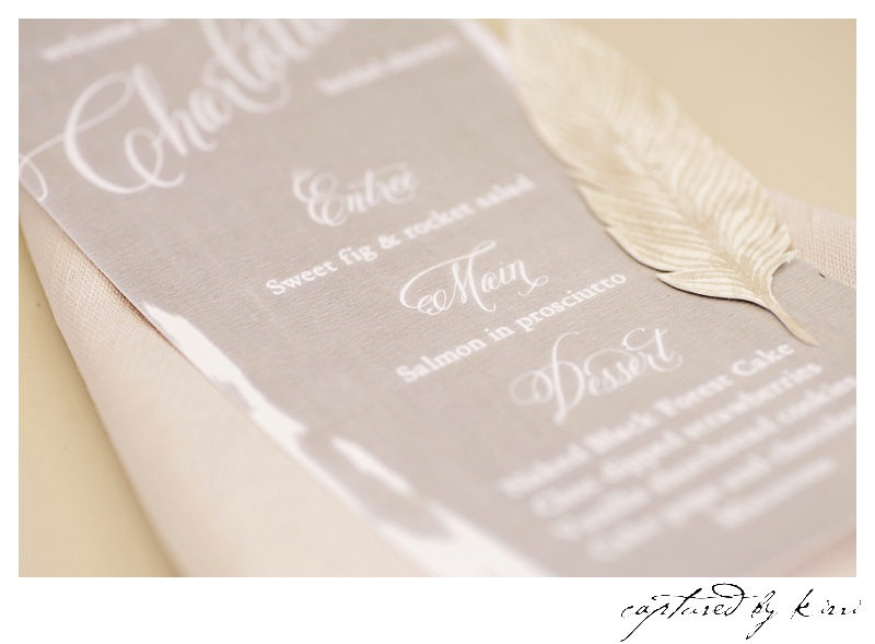 Hand-painted watercolour feathers by ELK Prints add another texture and dimension to the menu settings.