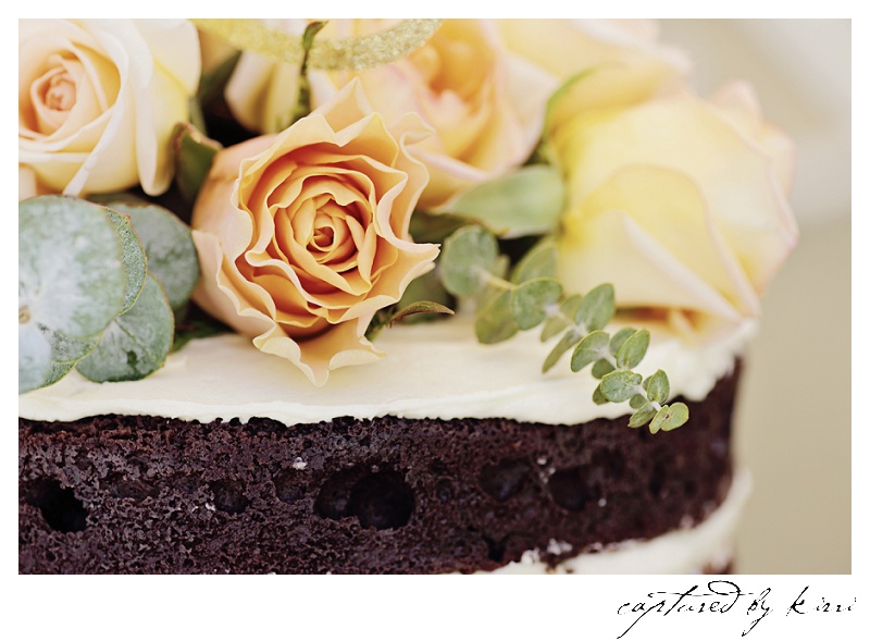 The textures and colours of the flowers contrast against the raw earthiness of the deep dark chocolate cake.