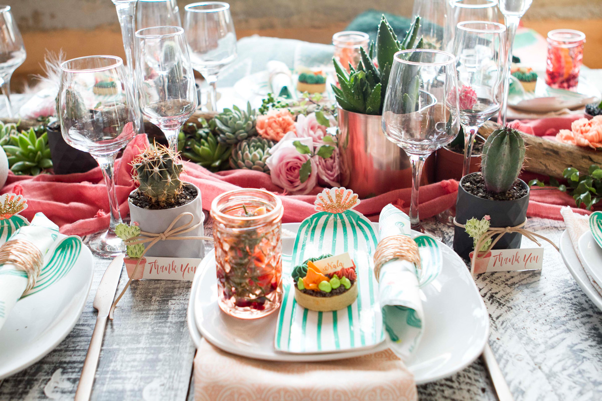 Succulents paired with wild roses are a beautiful textural centrepiece for the table. The cactus shaped party plates by Meri Meri from Favour Lane Boutique are a perfect choice for this theme.