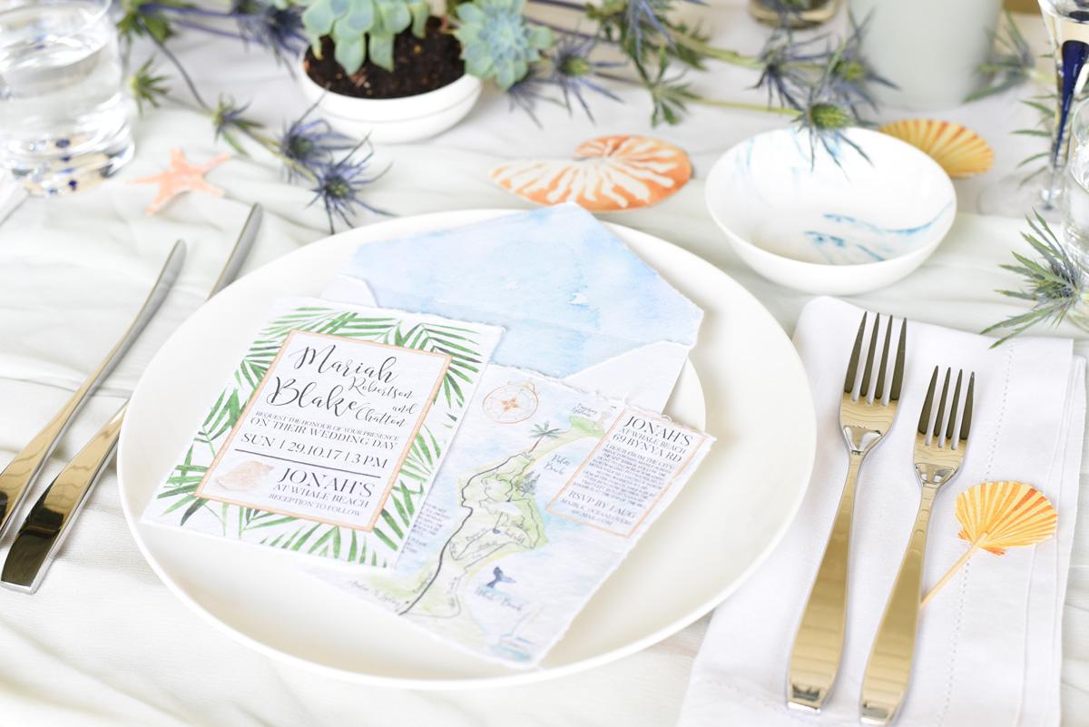 A coastal palm beach wedding invitation suite by ELK Prints in watercolours on Indie handmade paper.