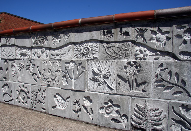 Cast concrete arwork with children and artist Lynn Takata