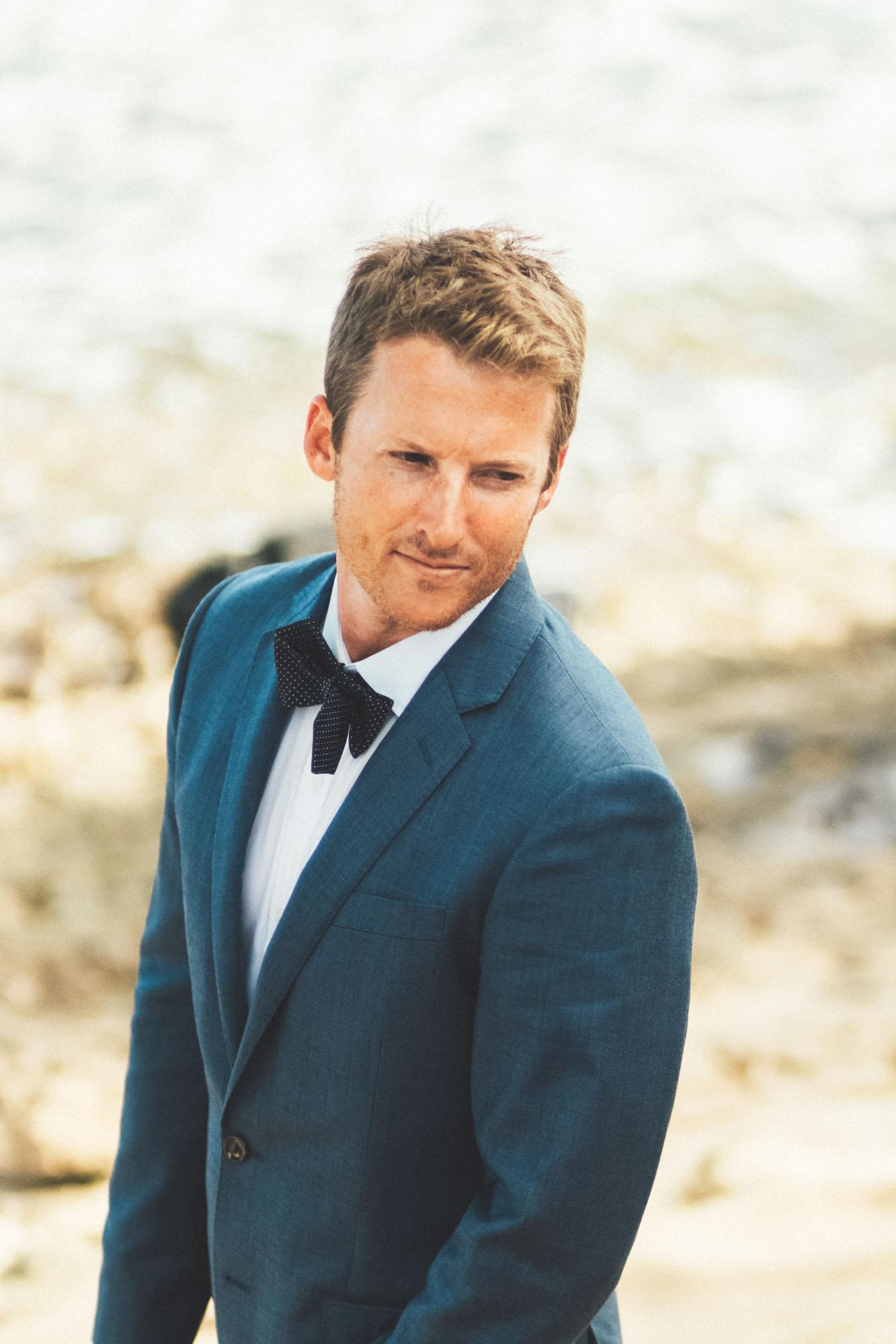 Kauai wedding groom with blue tux.jpg