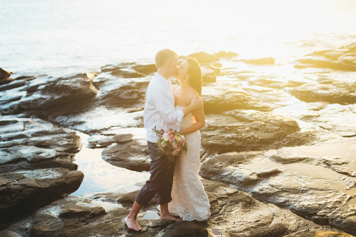 bride and groom sunset at merrimans kapalua.jpg