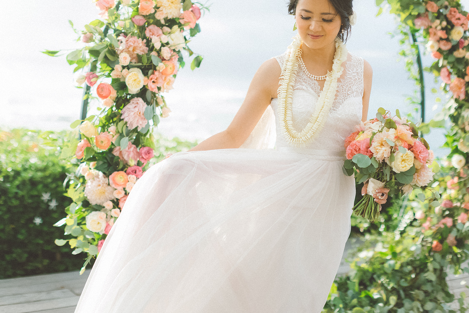 maui+beautiful+bride+in+floral+circular+arch+merrimans+kapalua+maui+wedding.jpg