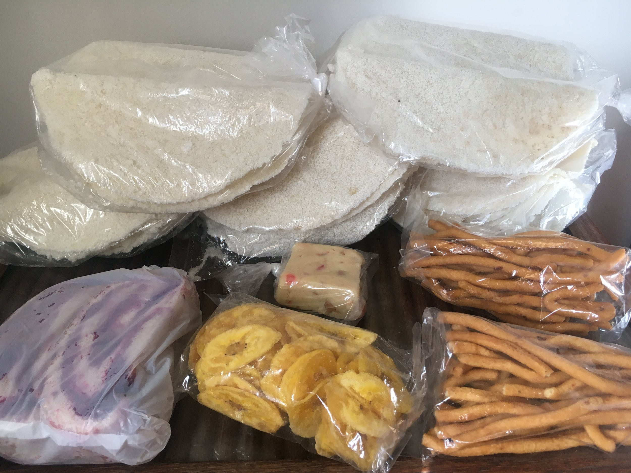 """I couldn't resist picking up a few local treats like cassava bread, salara (sweet bread with red-dyed coconut), plantain chips, fudge, and """"chicken foot"""" (thin cracker-like snack) from  Starbroek Market"""
