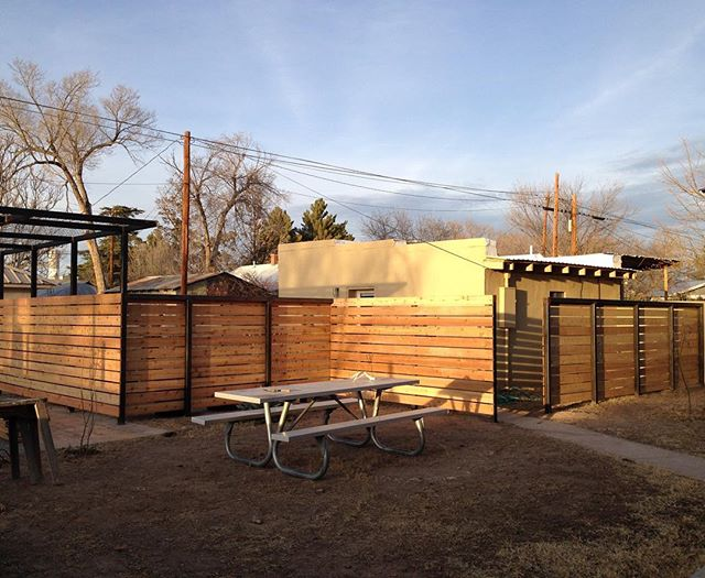 Almost done with with this cedar and steel fence shade structure combo.