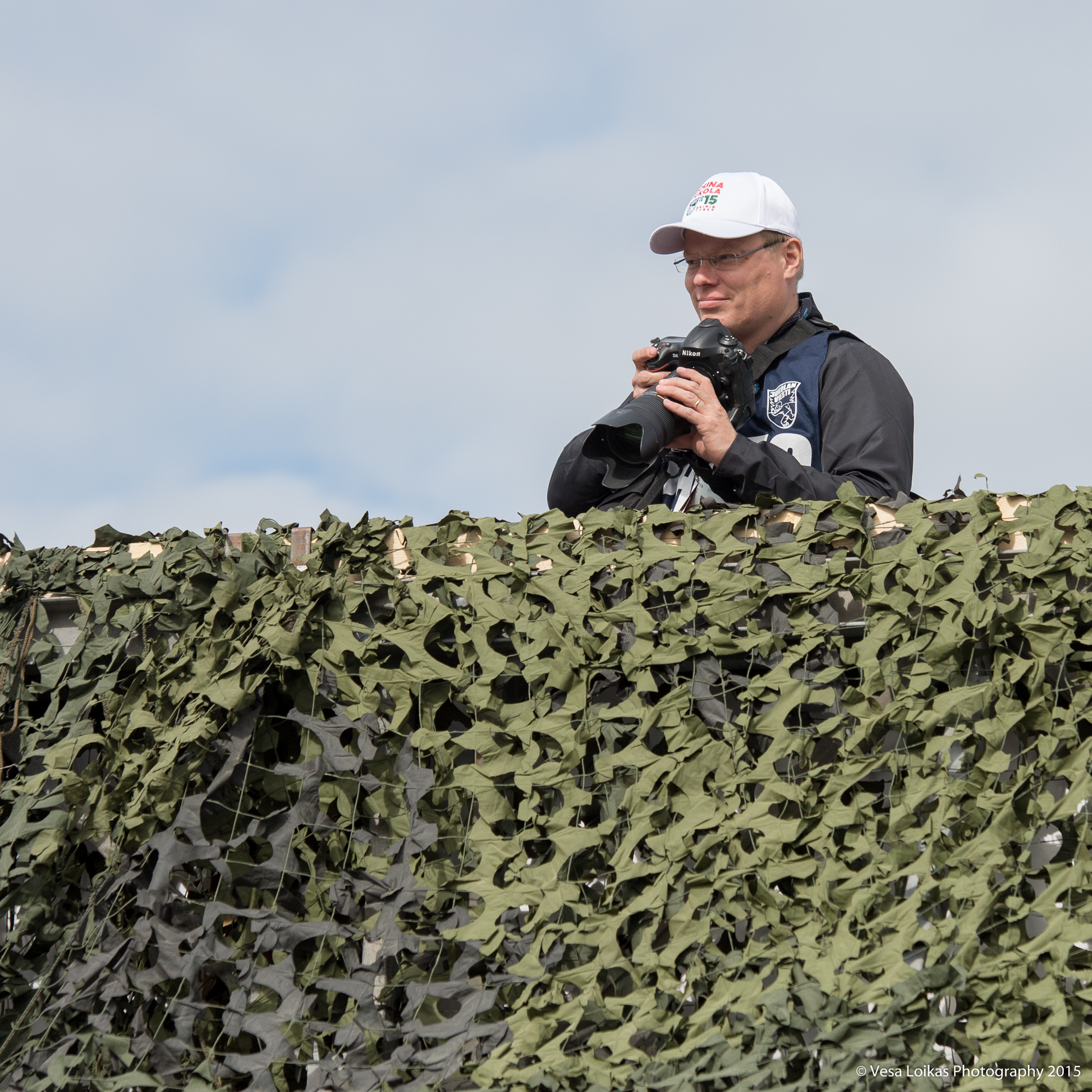 A colleague Ilkka Seppä checking out the angles on the bridge by the start area.