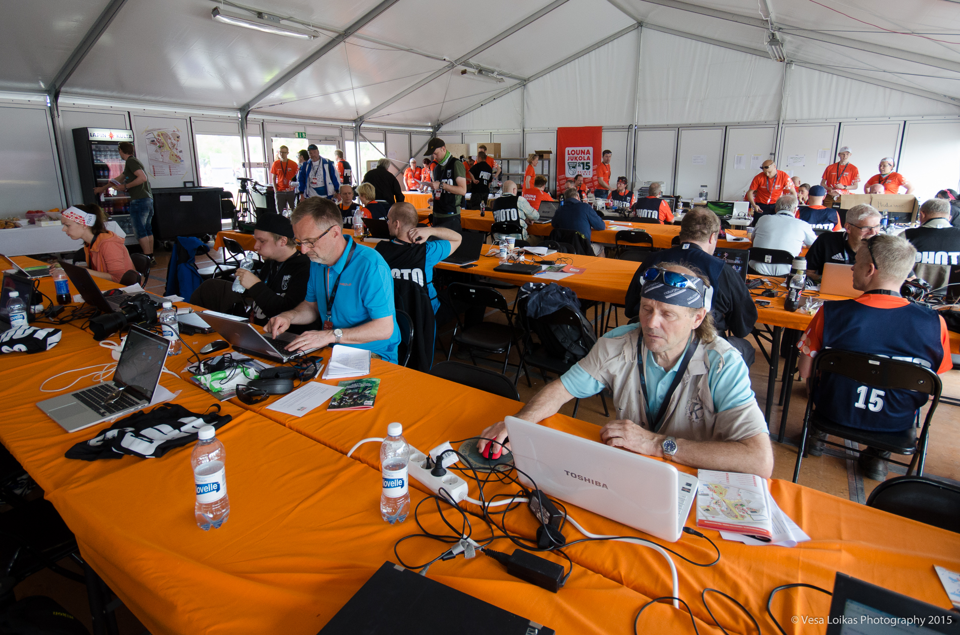 Media tent with journalists and photographers as well as webcast and social media crew.