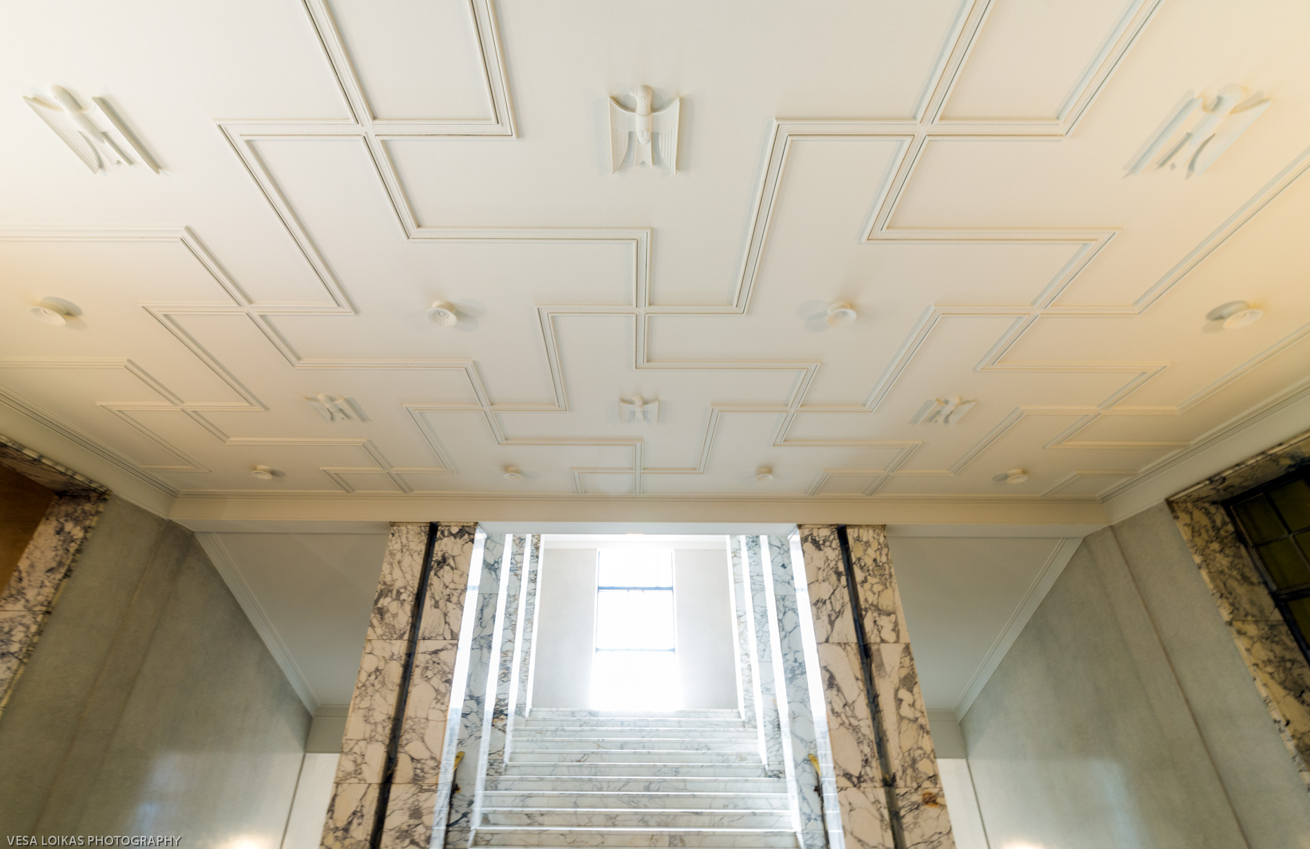 Ceiling detail in the decorative stair case with marble and stucco lustro surfaces.