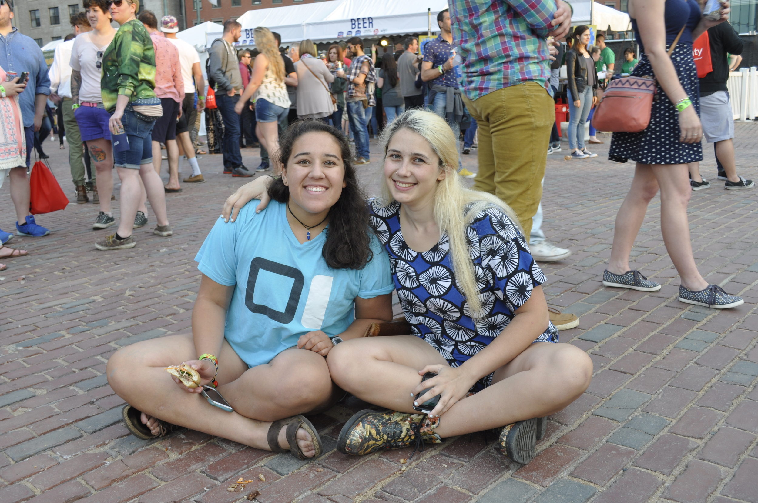Cara Starnbach(left) and Gabi Guttormsen(right) awaiting Sufjan Stevens at the Xfinity Red Stage
