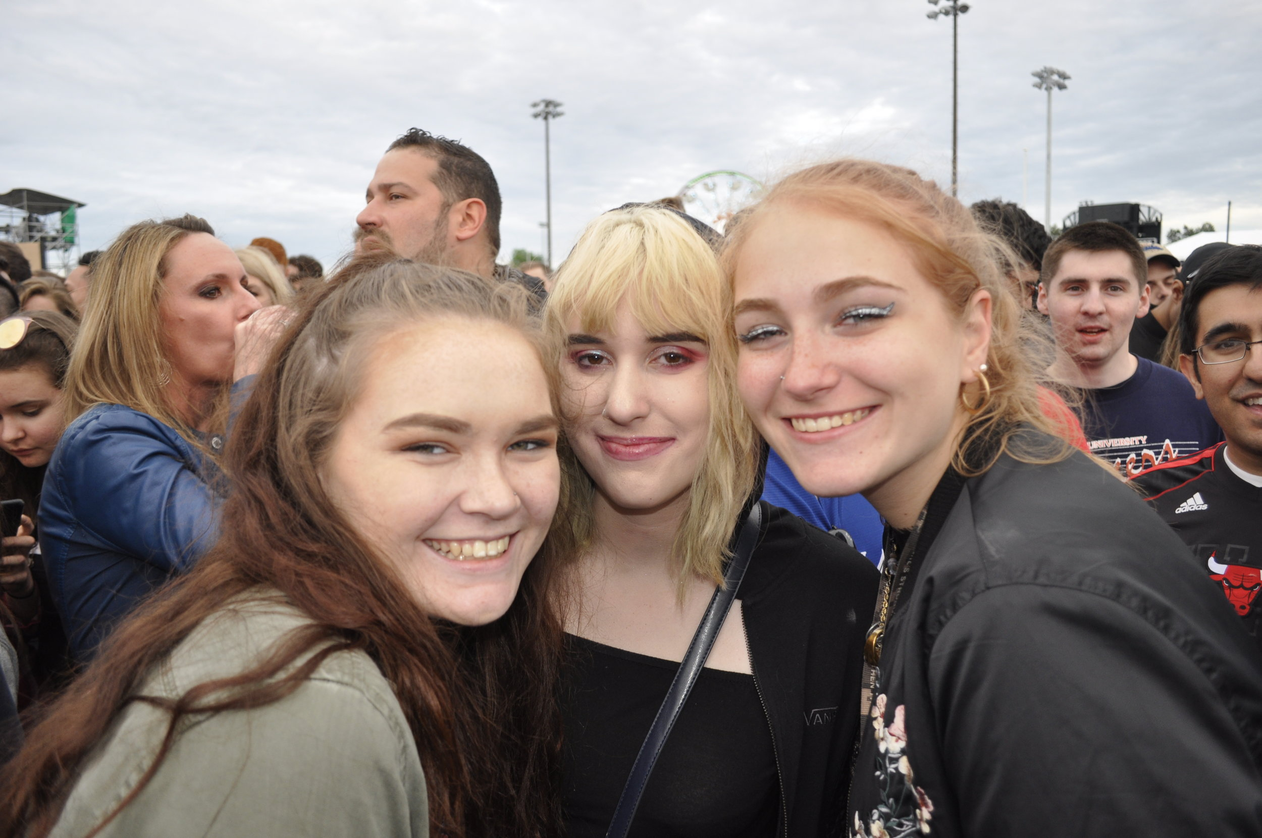 Festivalgoers(from left to right) Mackenzie Story, Lily Kray, and Riley Frederick waiting for The Xx to take the stage.